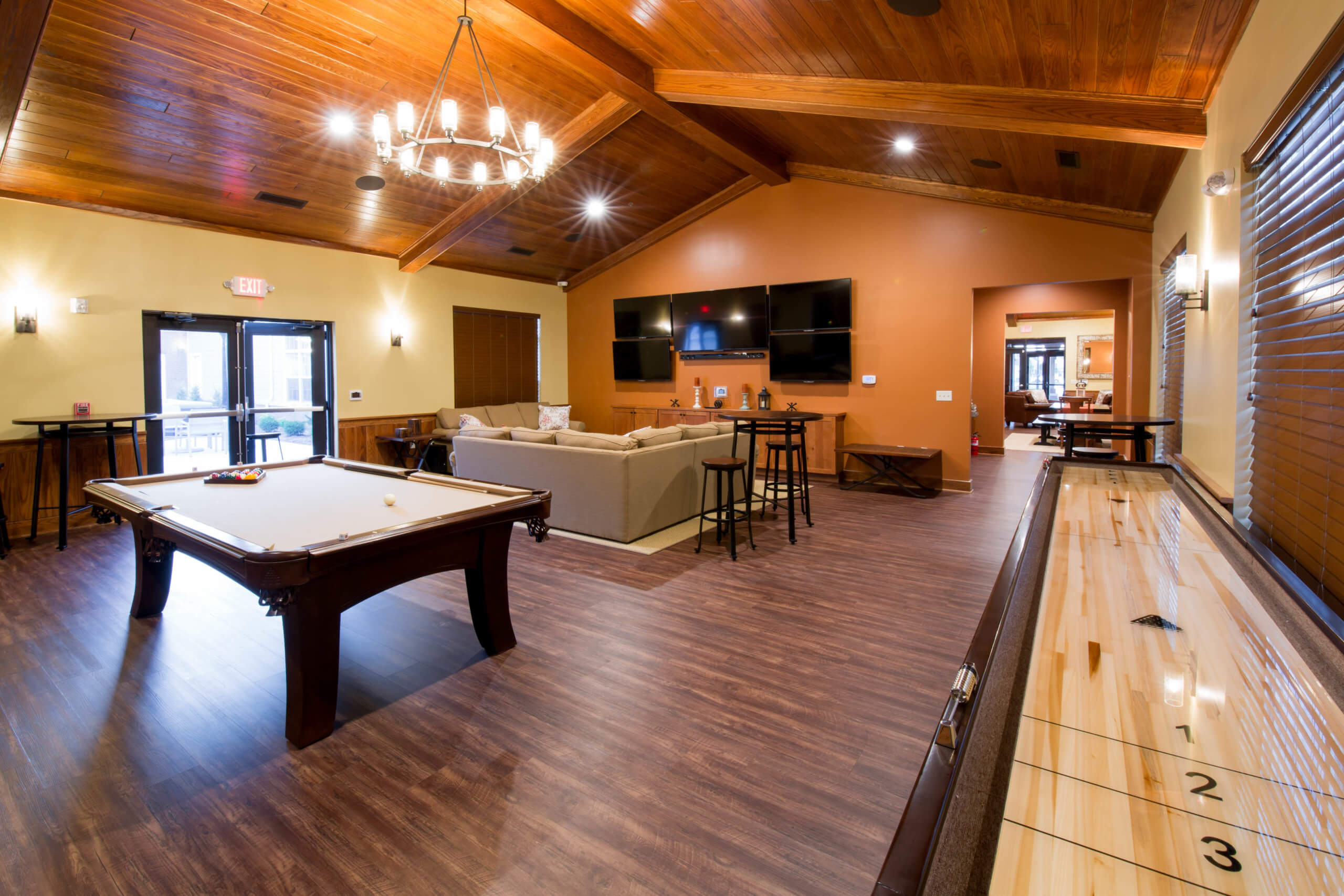 clubhouse interior with a pool table and shuffle board