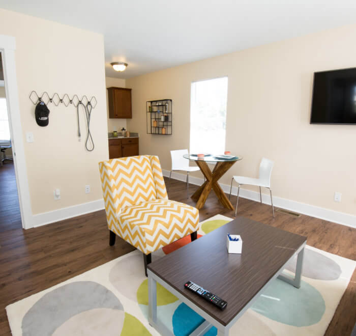 upstairs living area with kitchenette