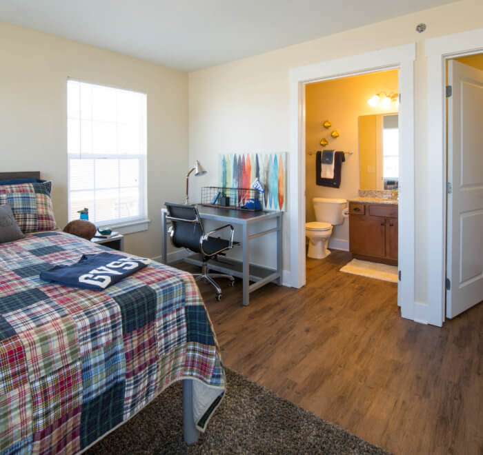 college bedroom with private bathroom and closet