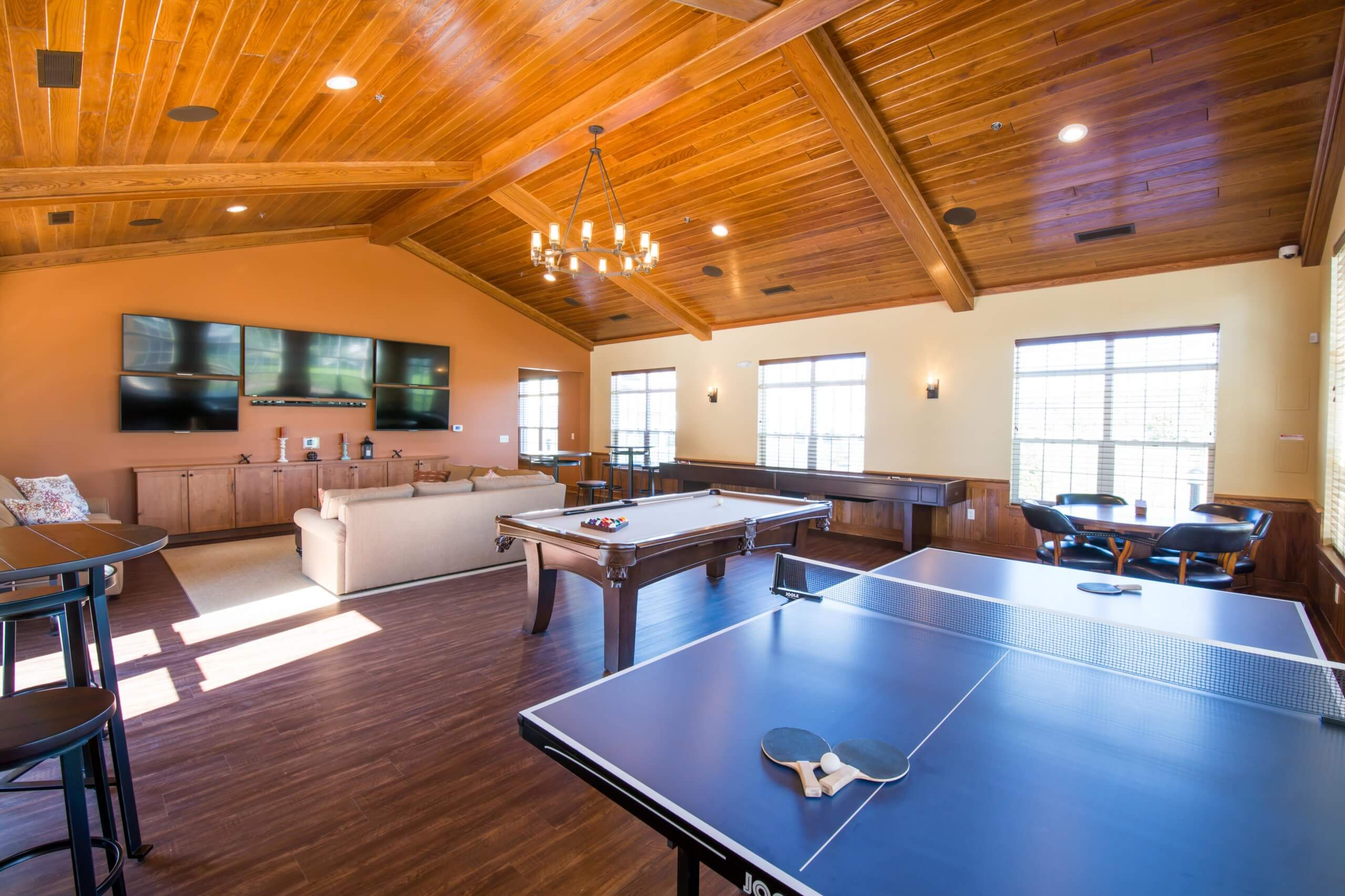 clubhouse with pool table and ping pong table