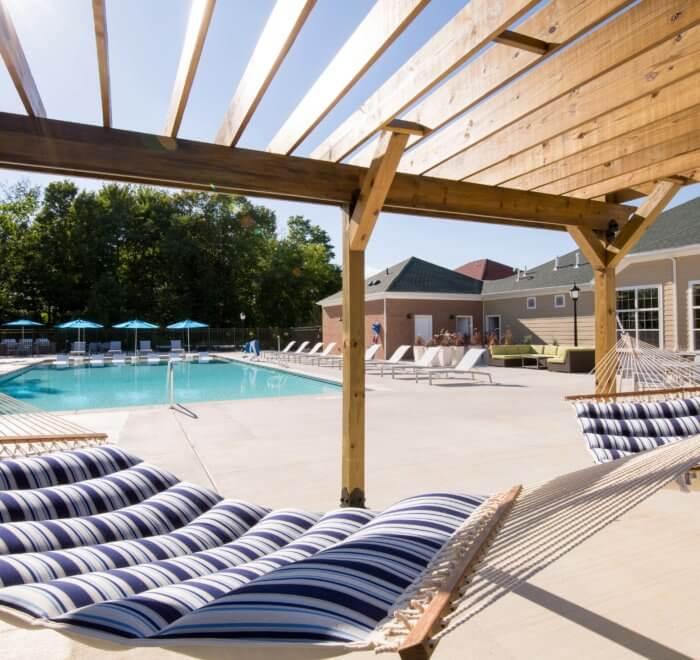 hammocks with pool in the background