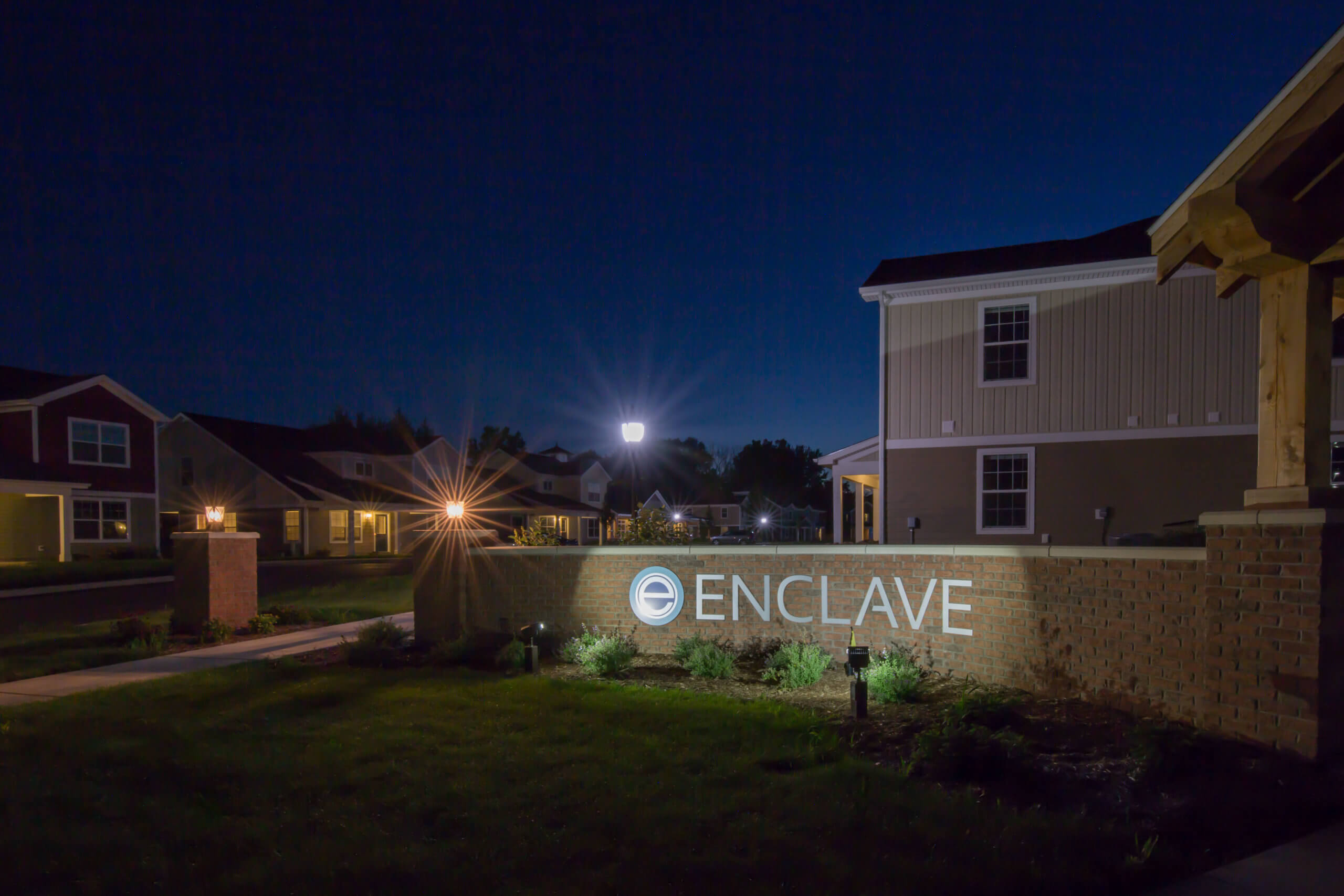 enclave entrance sign at night